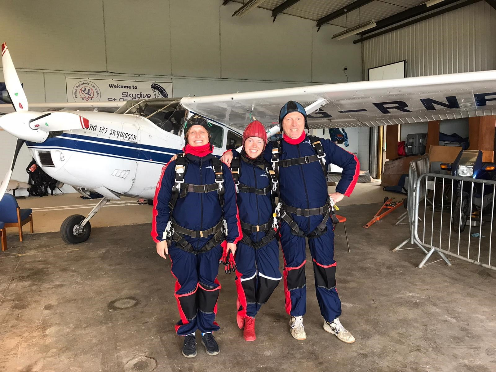 Emma, Katie and Jon Pattinson pose by the aeroplane before their fundraising skydive for VOCAL