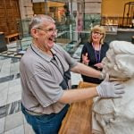 A man is guided around the exhibits on display at The Kelvingrove Art Gallery & Museum.